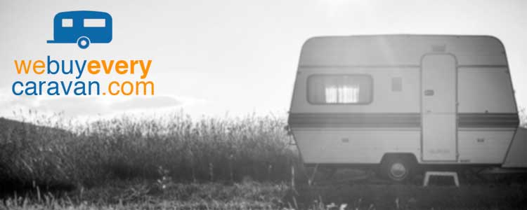 we buy any caravan black and white image of touring van